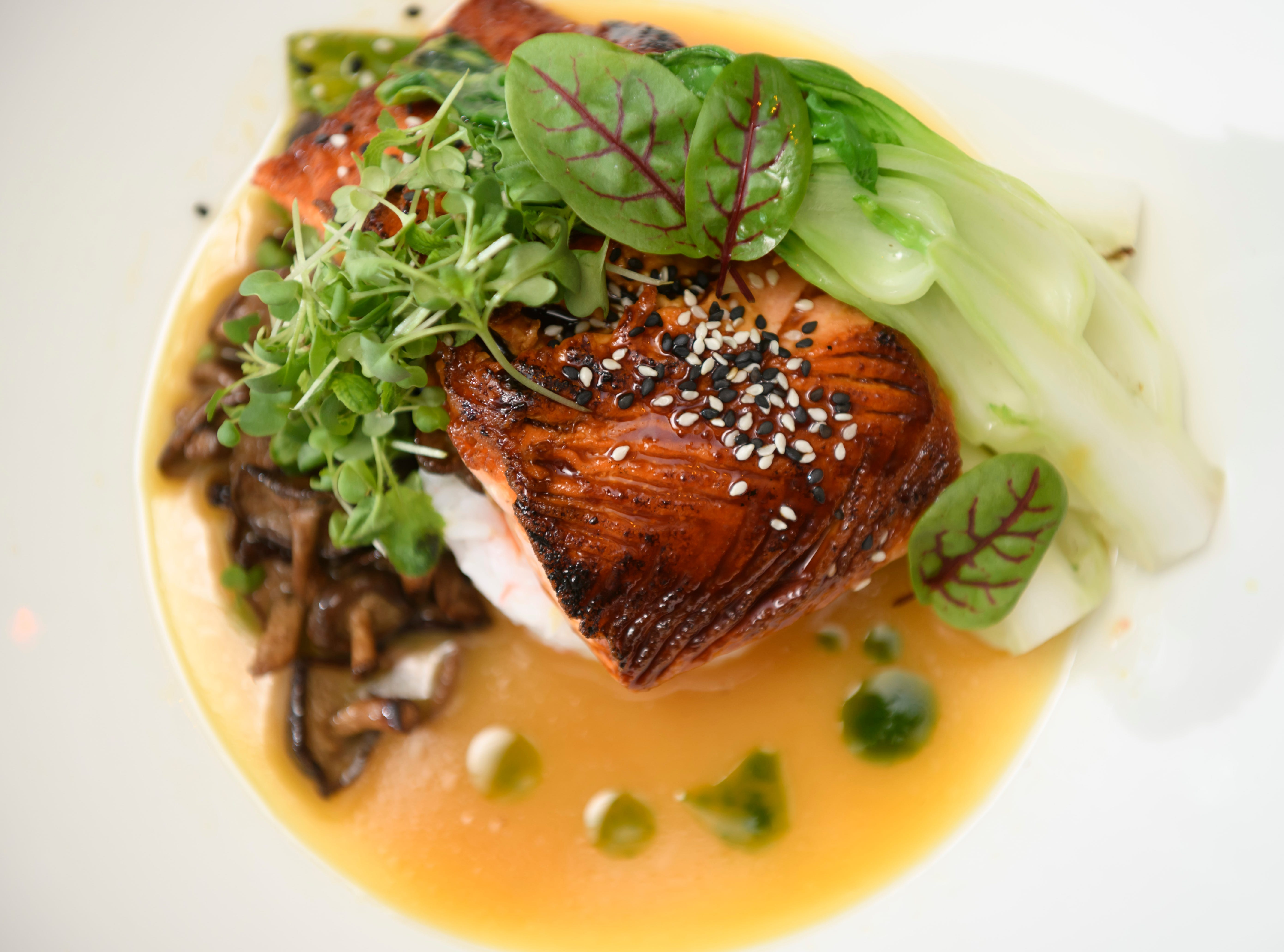 Ponzu glazed Fjord trout with ginger sushi rice cake, bok choy, baby shiitake mushrooms and orange-miso nage is one of the dishes at the new Vinotecca wine bar and restaurant in Birmingham, May 17, 2018.