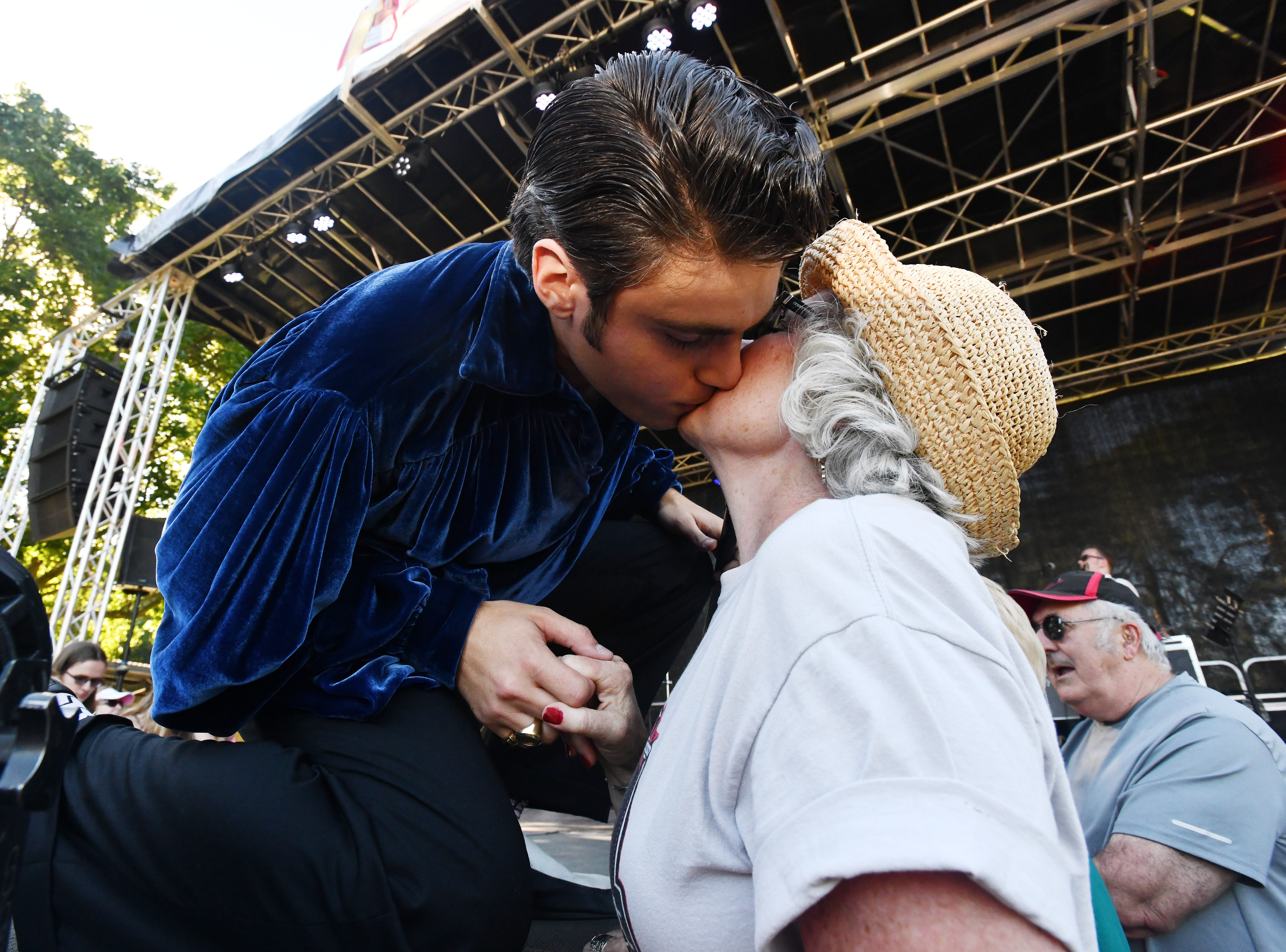 Elvis impersonator Jake Slater gives out a few kisses, including this one to Donna Brigman, during his set at the Michigan Elvisfest at Depot Town in Ypsilanti on July 6, 2018.