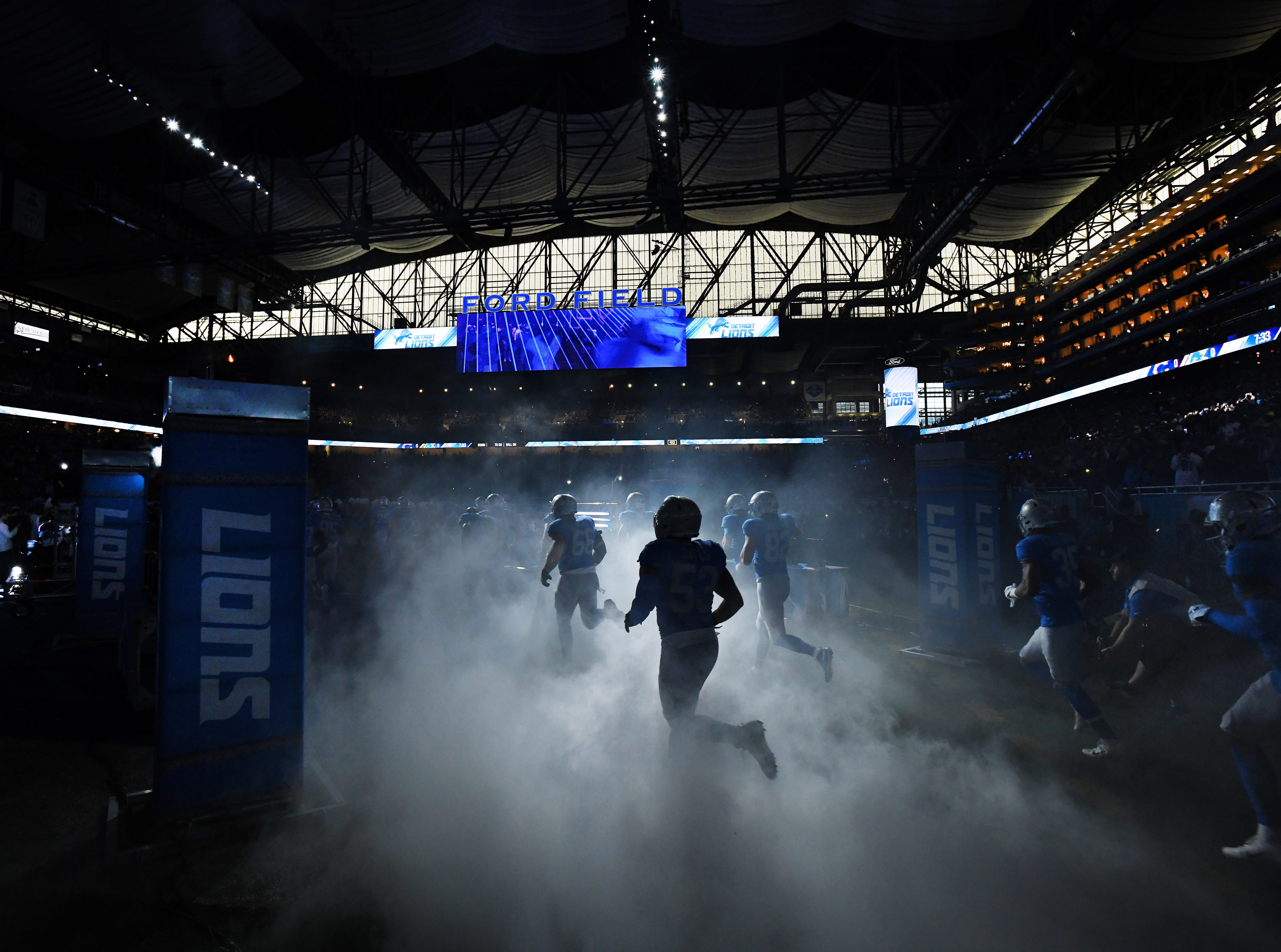 Detroit Lions  players charge out of the tunnel before their Thanksgiving Day game against the Chicago Bears, a 23-16 loss.