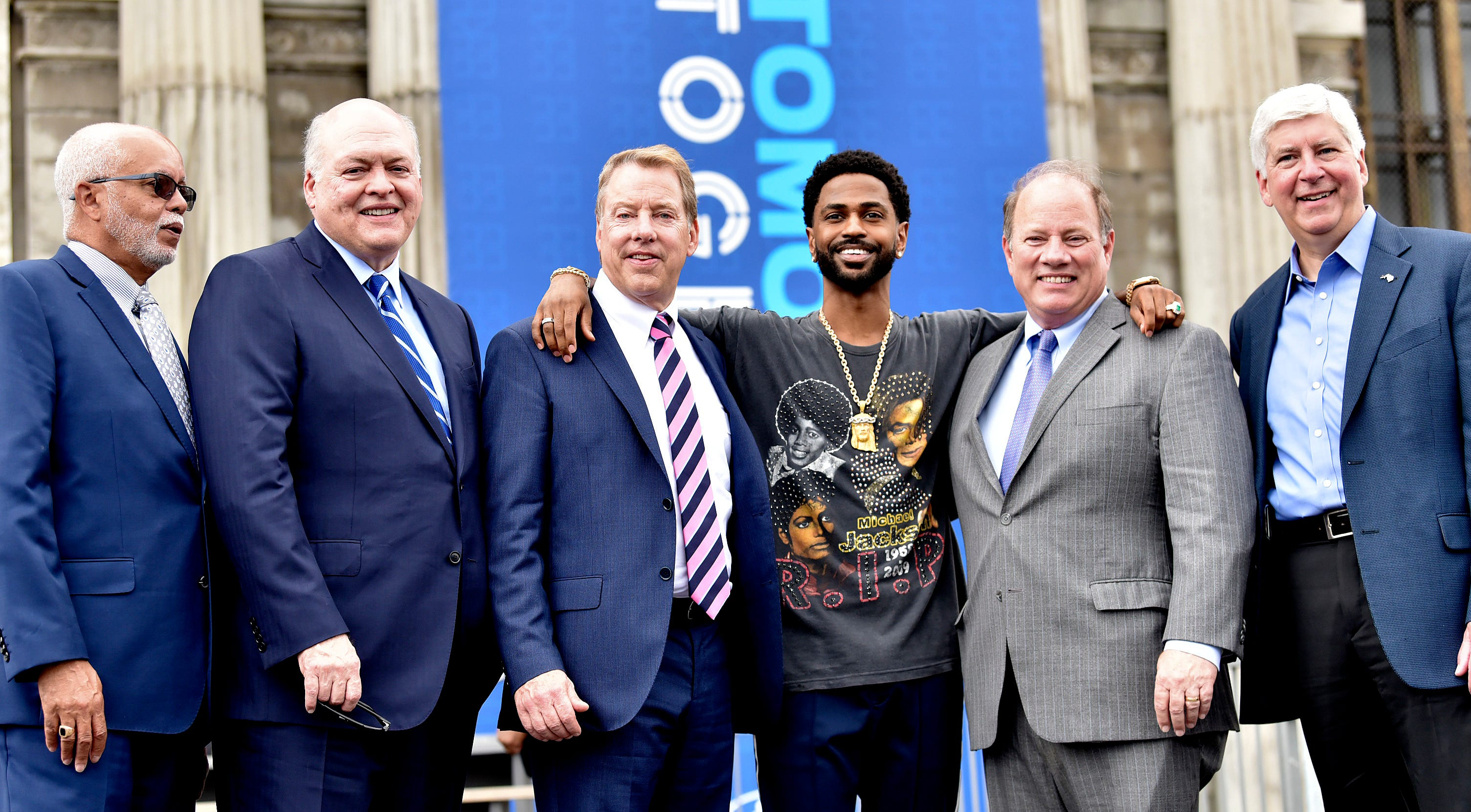 From left, Wayne County Executive Warren Evans, Ford President and CEO Jim Hackett, Ford Executive Chairman Bill Ford Jr., Detroit recording artist Big Sean, Detroit Mayor Mike Duggan and Michigan Gov. Rick Snyder pose in front of the Michigan Central Station on June 19, 2018. The long-abandoned 1914 train station will become Ford's center for autonomous vehicle development.