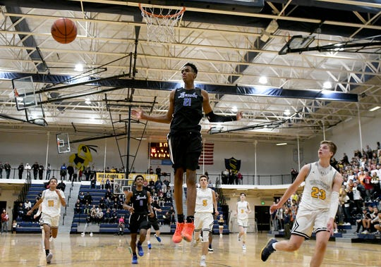 The ball zips past Lincoln High School freshman Emoni Bates, center, who was cruising in for what looked like another dunk in the fourth quarter.