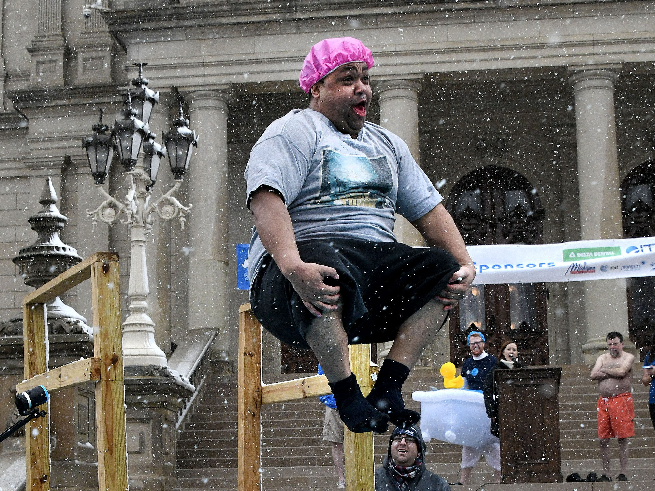 Cannonball! State Sen. Coleman Young Jr. tucks his knees for maximum splash into icy water as legislators and capitol workers take the Legislative Polar Plunge in front of the Capitol on March 1, 2018 to benefit Special Olympics of Michigan.