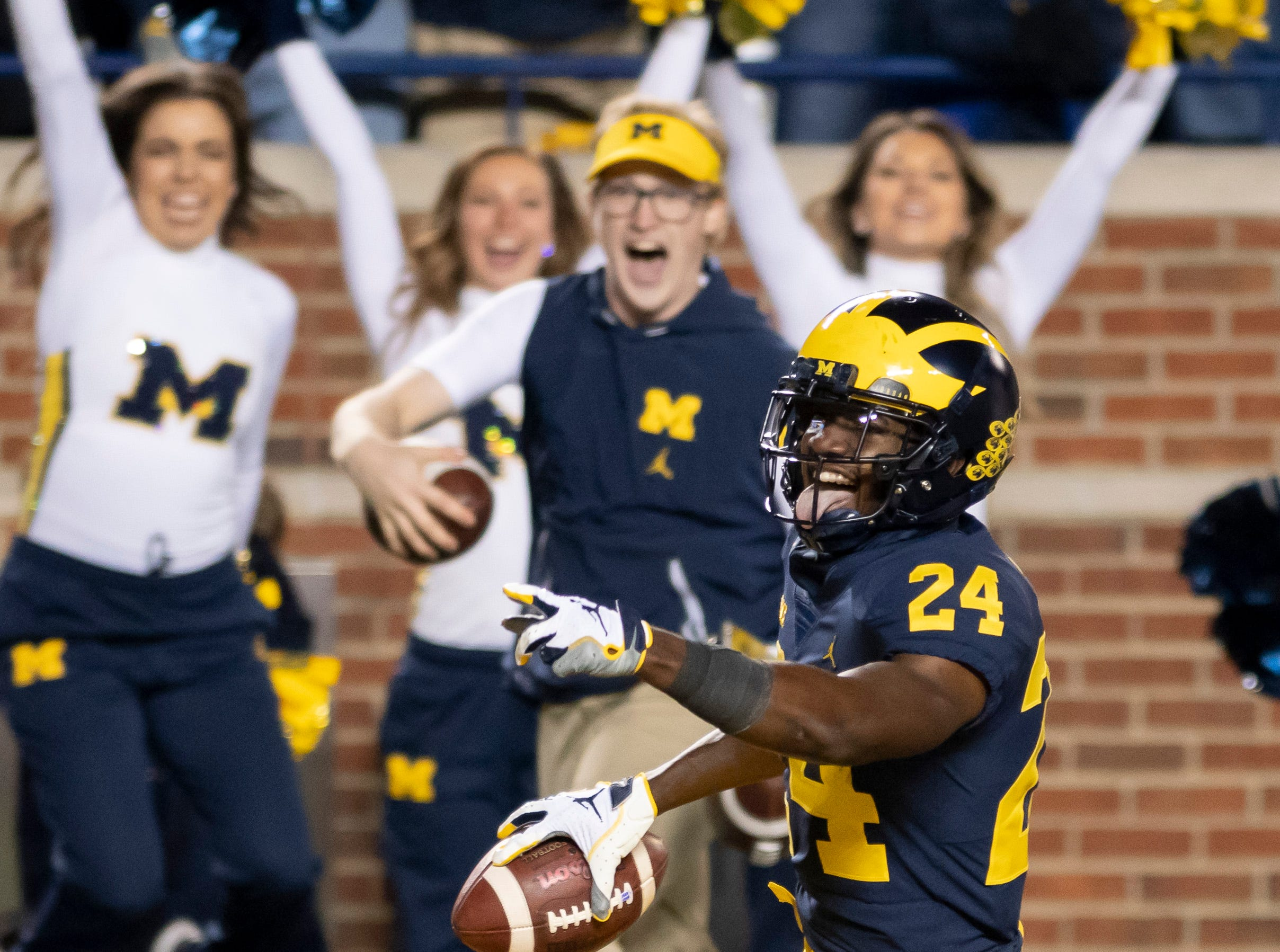 Michigan defensive back Lavert Hill (Detroit King) smiles and sticks his tongue out as he scores a touchdown after intercepting a fourth-quarter pass against Wisconsin at Michigan Stadium, in Ann Arbor, October 13, 2018. The Wolverines avenged a loss to the Badgers the previous year by pounding them at home 38-13.