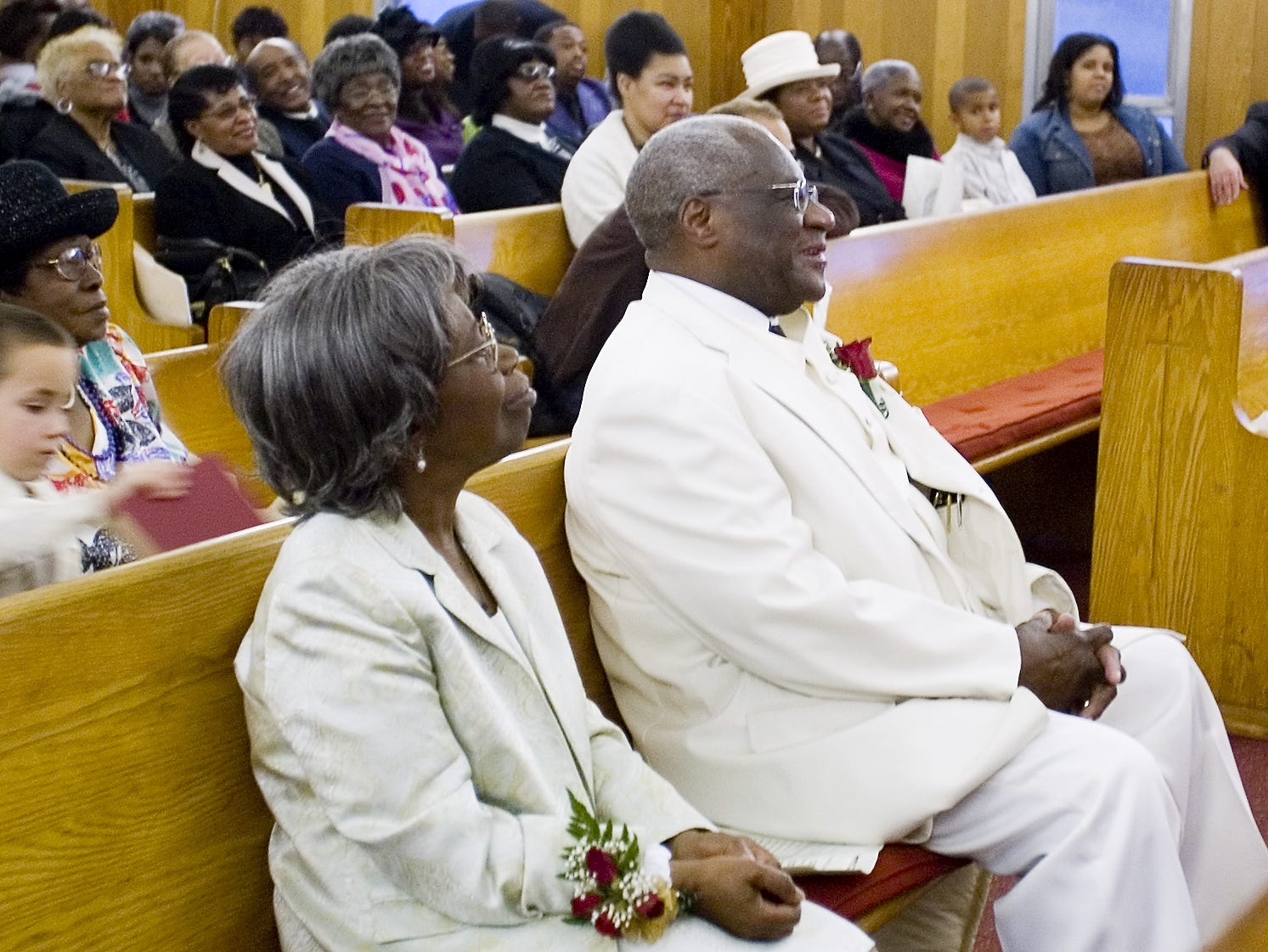 The Rev. Cephus McGee and his wife, Verlene, listen as speakers praise his 45 years of service at the All Saints  Home Church of God in Christ in Elmira in 2006.