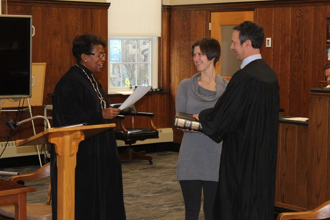 New Ohio Supreme Court Justice Melody Stewart swore in Sandusky County District 1 Judge John Kolesar, standing with his wife, Jacqueline, Thursday at the Sandusky County Courthouse.
