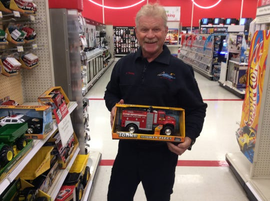 Retired Poudre Fire Authority employee Mike Fleming is pictured purchasing gifts for children through the Salvation Army's Angel Tree program a few years back.