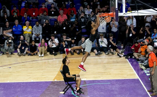 Darrick Jones, Jr. dunks after catching a pass from fellow dunk contest competitor Cole Anthony in the City of Palms Classic Dunk Contest on Wednesday, December 19, 2018, at Florida Southwestern State College in Fort Myers.