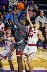 Petal's Caleb McGill gets the shot off on Glens Falls' Nick Danahy. City of Palms Classic Glens Falls NY vs. Petal Mississippi.