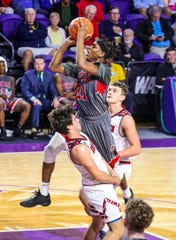 Petal's Don Avila is called for a charge on Glens Falls' David Barclay as he flies to the basket. City of Palms Classic Glens Falls NY vs. Petal Mississippi.