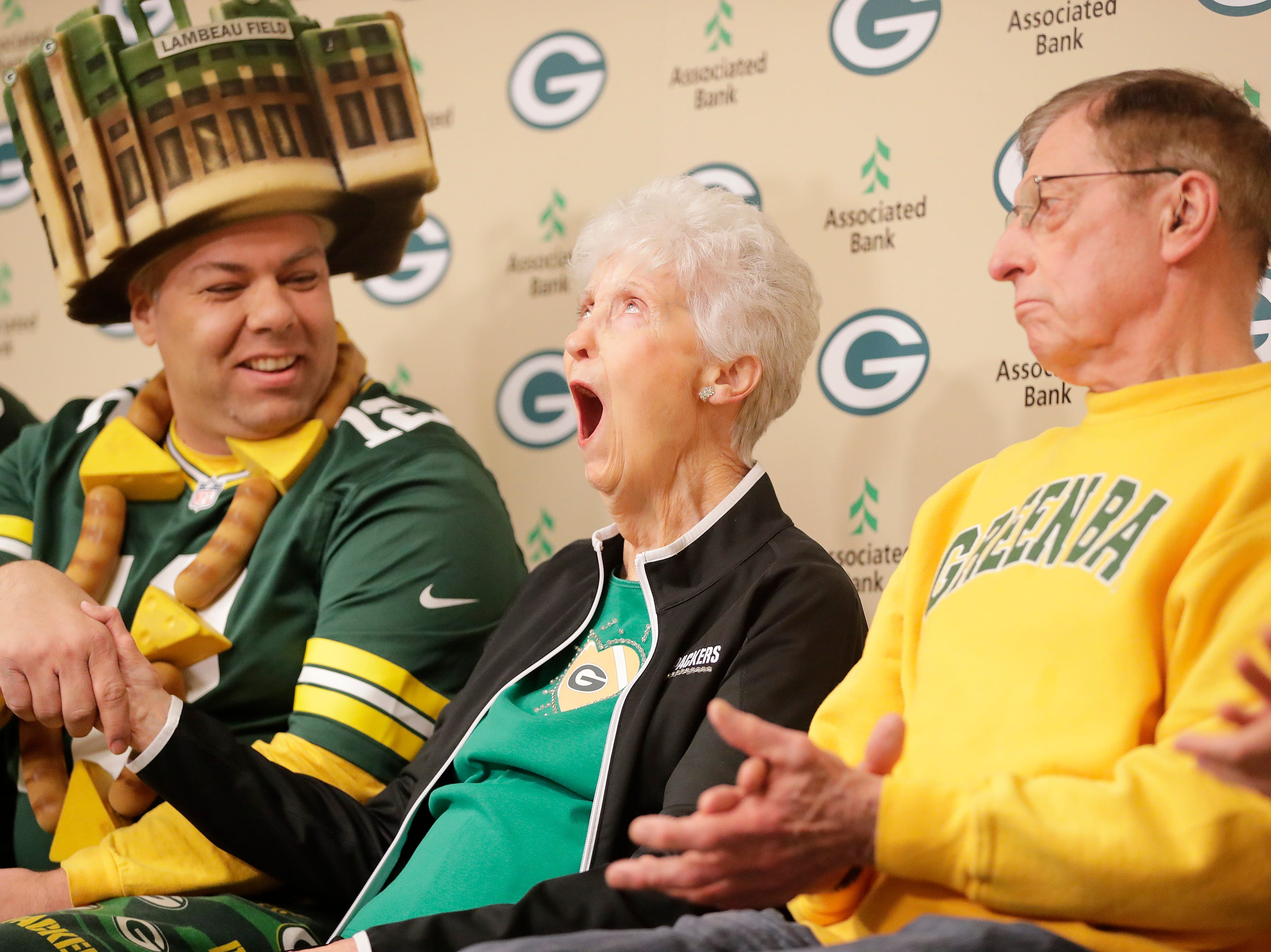 Marguerite Bachhuber of Green Bay reacts as she is as honored as the 20th member of the Green Bay Packers fan hall of fame at Lambeau Field on Tuesday, February 13, 2018 in Green Bay, Wis.