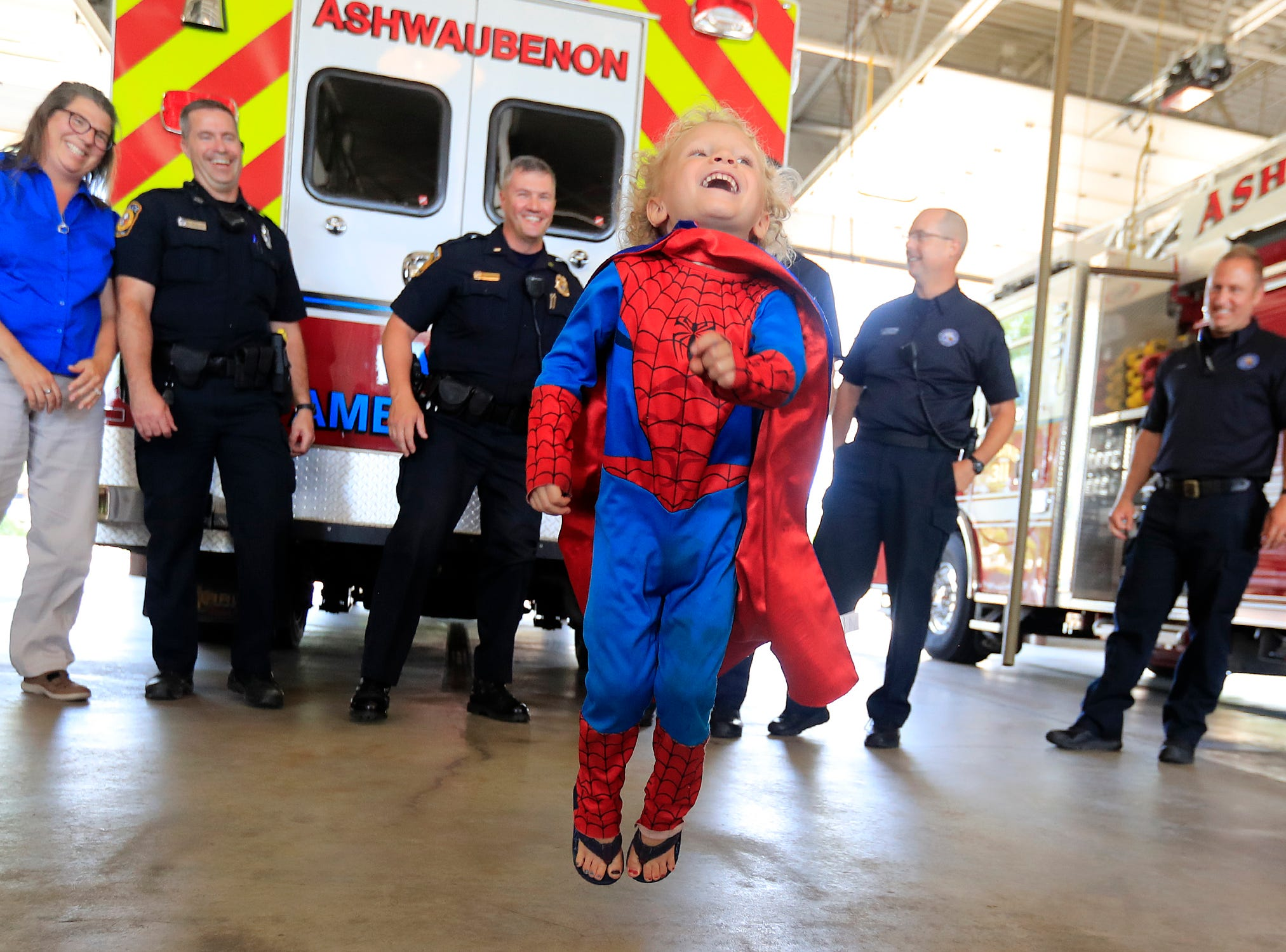 Calyx Harnowski, 3, runs around fire trucks and ambulances while meeting the first responders that saved his life a couple weeks ago when he nearly drowned at a pool party on Tuesday, July 10, 2018 in Ashwaubenon, Wis.
