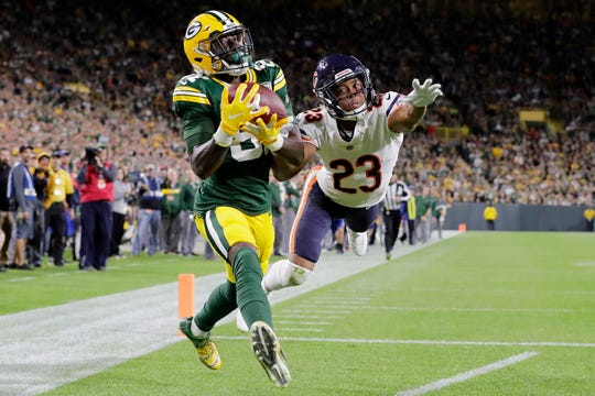 Green Bay Packers wide receiver Geronimo Allison (81) catches a 39-yard touchdown pass as Chicago Bears defensive back Kyle Fuller (23) defends in the fourth quarter at Lambeau Field on Sunday, September 9, 2018 in Green Bay, Wis.