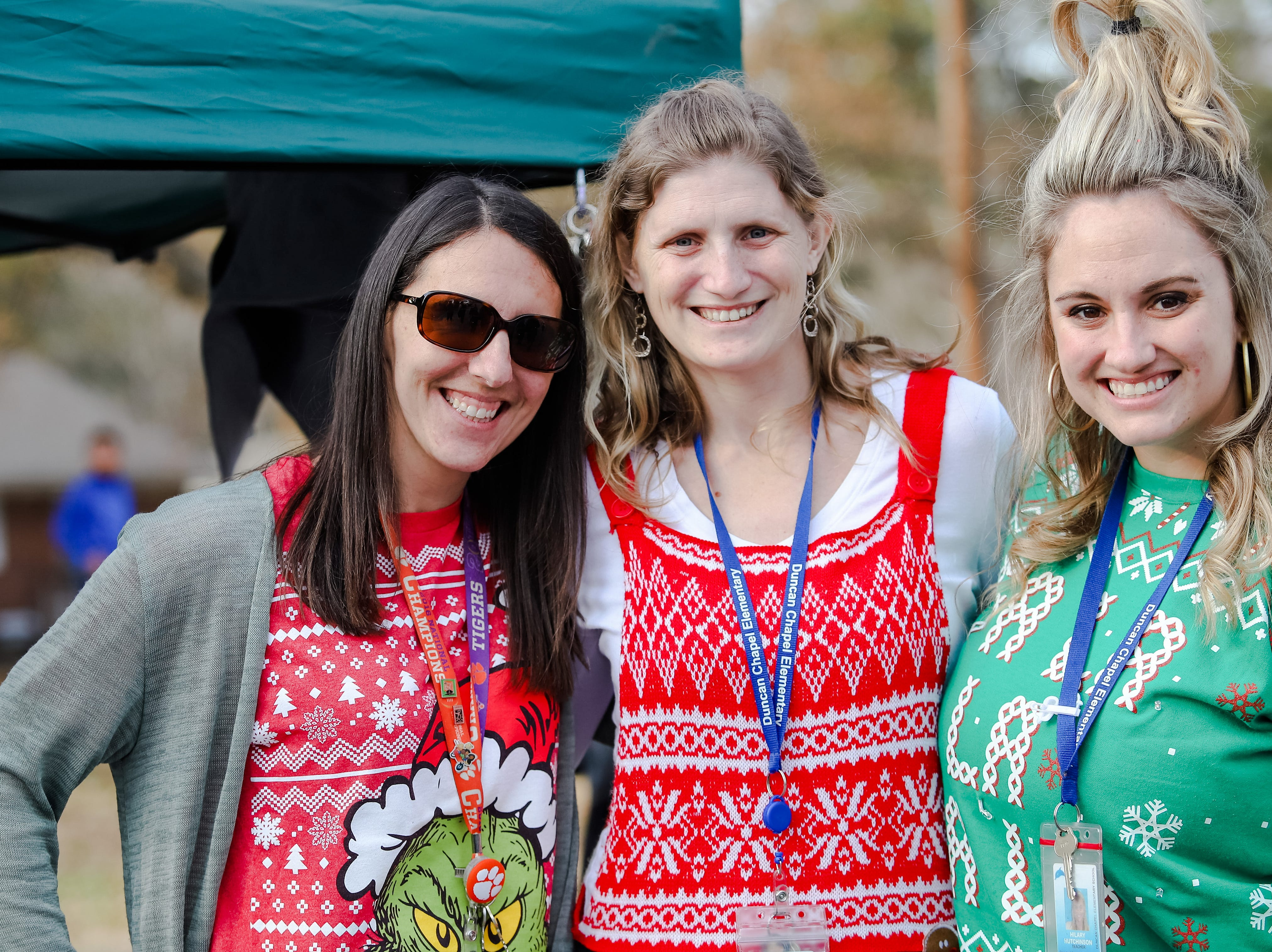 "Duncan Chapel teachers Erica Drew, Shannon Ellingson, and Hilary Hutchinson enjoy passing out hot chocolate to their students.   Molina Healthcare of  South Carolina and Duncan Chapel  Elementary  School  hosted  ""Christmas in the Community; to  get into the season of giving and spread holiday cheer among Greenville residents on Wednesday, Dec. 19, 2018."