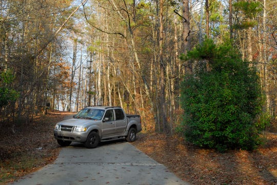 A pickup blocks the road leading to the off campus Sigma Nu house near Clemson University Monday, Dec. 10, 2007.