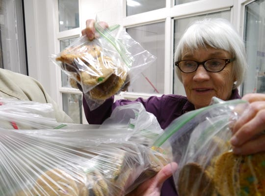 Judy Ericksen chooses from bags of homemade cookies. Ericksen and other volunteers have made their cookie pass at the Cascade County Detention Center a holiday habit.