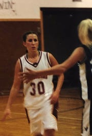 Former Fort Benton standout Kyle Cook brings the ball in the frontcourt in a 2001 District 1B game against Fairfield.