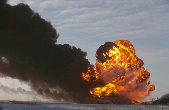 In this Dec. 30, 2013 file photo, a fireball goes up at the site of an oil train derailment near Casselton, N.D.