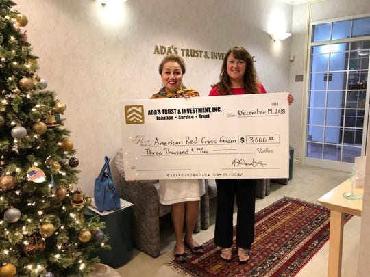 Ada's Trust & Investment, Inc., annual Holiday Program donated $3,000 to the American Red Cross.  Shown are: Chita Blaise, CEO, Red Cross and Patty Ada, vice president, Ada's Trust & Investment, Inc.