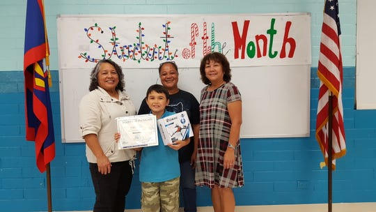 The Guahan Academy Charter School honored its November Student of the Month awardees on December 13, 2018. Front row: Dallas Cauthen.  Back row from left: Mary Mafnas, dean of elementary school, Guahan Academy Charter School; Bernie Cauthen and Teresita Cruz, Dean of High School Guahan Academy Charter School.