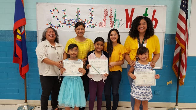 The Guahan Academy Charter School honored its November Student of the Month awardees on December 13, 2018. Pictured from left: Sharina Rechy; Chorisa Teresio and Craijah Castro. Pictured in back row from left: Mary Mafnas, dean of elementary school Guahan Academy Charter School; Michelle Calvo; Camarin Sablan and Natasha Aldridge.