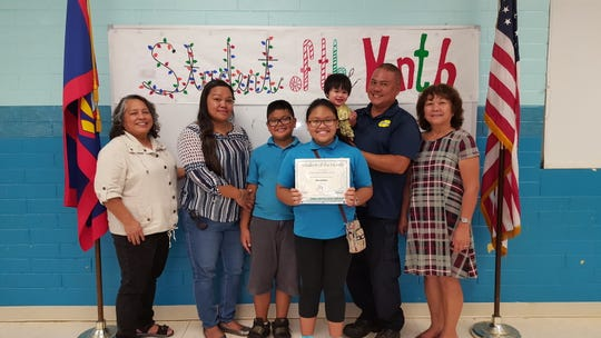 The Guahan Academy Charter School November Student of the Month awardees pictured on December 13, 2018. Front row from left: Ciana'lyn Sablan-Cruz. Back row: Mary Mafnas, dean of elementary school Guahan Academy Charter School; Josett Cruz; Kenapu Sablan-Cruz; Kenneth Cruz with his baby Kenoa Sablan-Cruz and Teresita Cruz, dean of high school Guahan Academy Charter School.