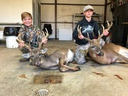 Parsons Griffith, 12, left, and Stuart Griffith, 14, hunted with their dad, Dr. Cameron Griffith, to tag these trophy bucks. Parsons' deer, a 9-point, was his first, while Stuart dropped an 8-point.