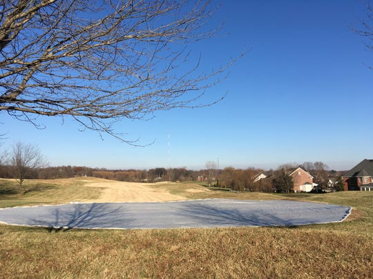 """Some of the restored greens at the newly named The Bridges Golf Course of Henderson have been tucked in for the winter under """"grow covers."""""""