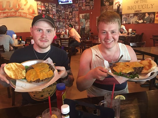 Gudbjorn Johann (left) and Sindri Mar Smarason enjoy a massive American burger.