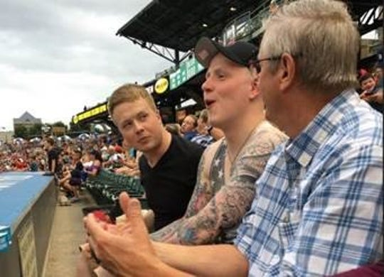 Gudbjorn Johann (middle) at the Indians game before his surgery to remove a 6-pound cancerous tumor in his chest.