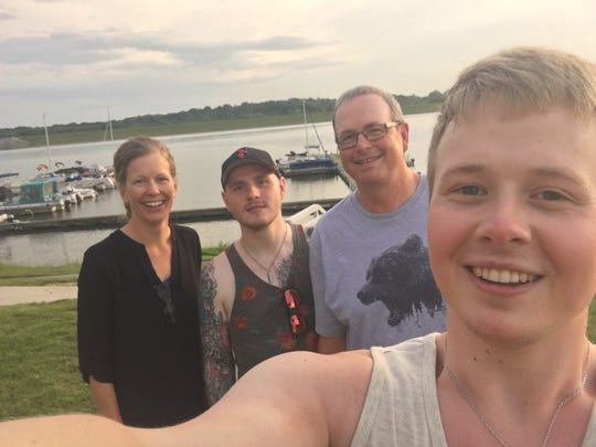 Christina Tiller (left) and husband Jerry became close friends with Gudbjorn Johann (middle) and Sindri Mar Smarason as Johann fought testicular cancer.