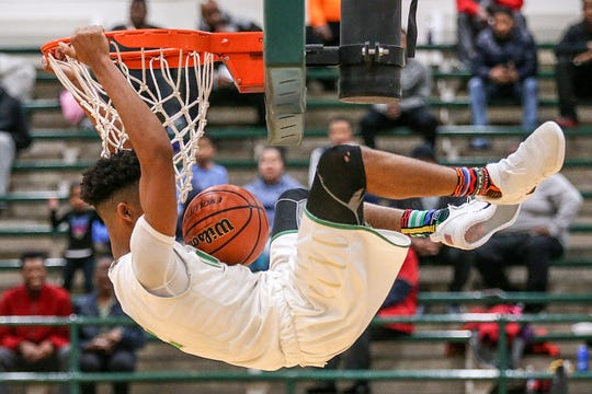 Cathedral Fighting Irish guard Armaan Franklin (2) dunks during first half action between the Cathedral Fighting Irish and Emmerich Manual Redskins in city tournament semifinals at Arsenal Technical High School, Indianapolis, Saturday, Jan. 20, 2018. Cathedral won, 65-48, moving on to finals.