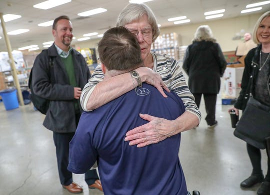 """Sister Louise Hoeing hugs Chris Foy at St. Vincent de Paul Food Pantry on Thursday, Dec. 20, 2018. Foy has volunteered at the pantry for 10 years, six of which with Tony Baugh, a direct support professional with Noble of Indiana. Foy spends two hours every Thursday packing or sorting various foods and also volunteers on Wednesdays with his father, Dave, driving food to those without transportation. """"We connect every week,"""" said Hoeing. """"Every Thursday I get my hug."""" Noble aims to give opportunities and enhance the quality of life for people with disabilities through individualized services."""