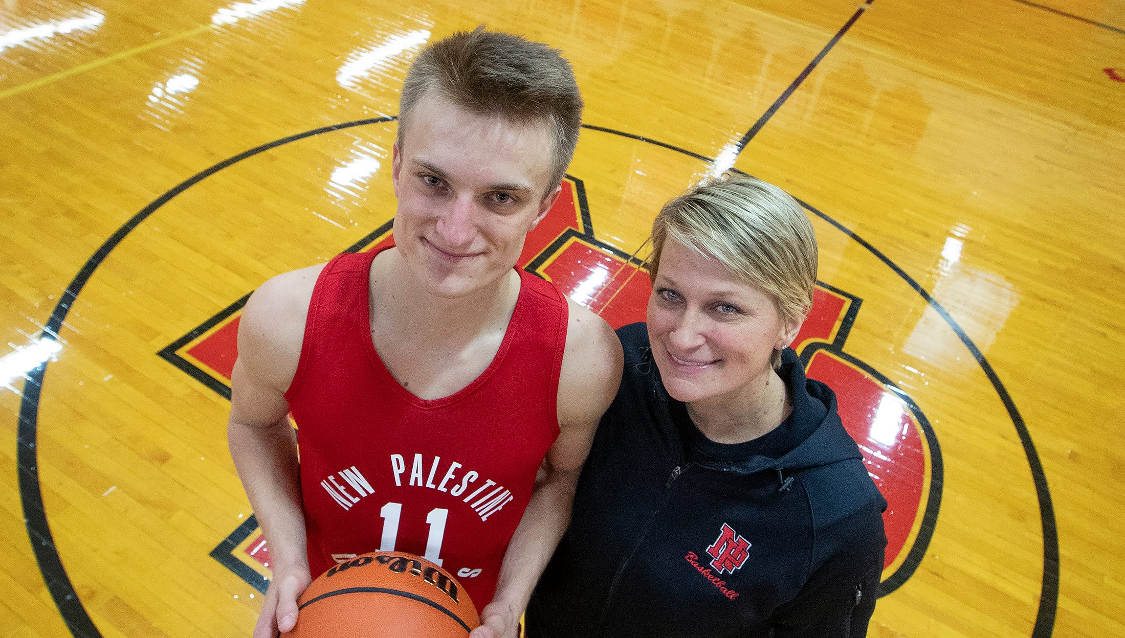 New Palestine basketball's Maximus Gizzi and his...