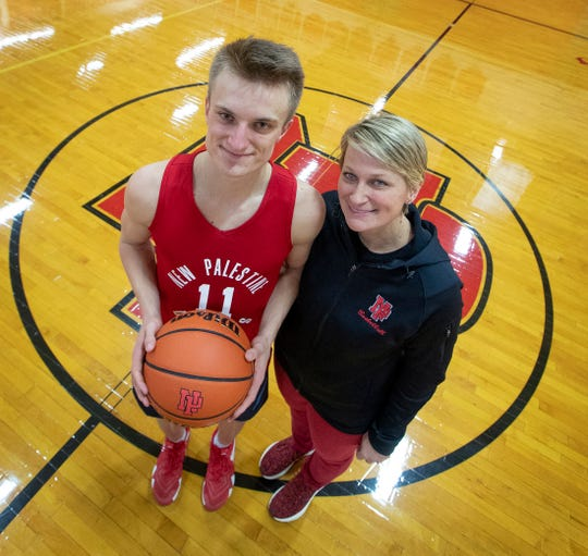 New Palestine basketball's Maximus Gizzi and his mother Sarah Gizzi. Maximus is a standout junior point guard and his mother Sarah coaches New Pal's girls team.