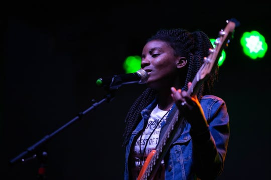 Nicole O'Neal, a local singer and bass player, is a co-founder of WOO GRL Fest.
