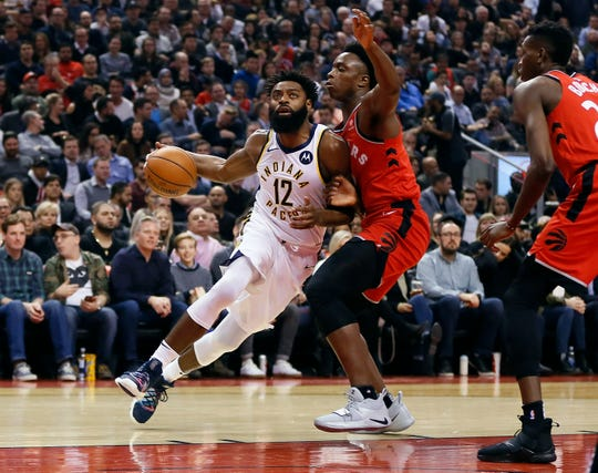 Dec 19, 2018; Toronto, Ontario, CAN; Indiana Pacers guard Tyreke Evans (12) drives to the net against Toronto Raptors forward OG Anunoby (3) during the first half at Scotiabank Arena.