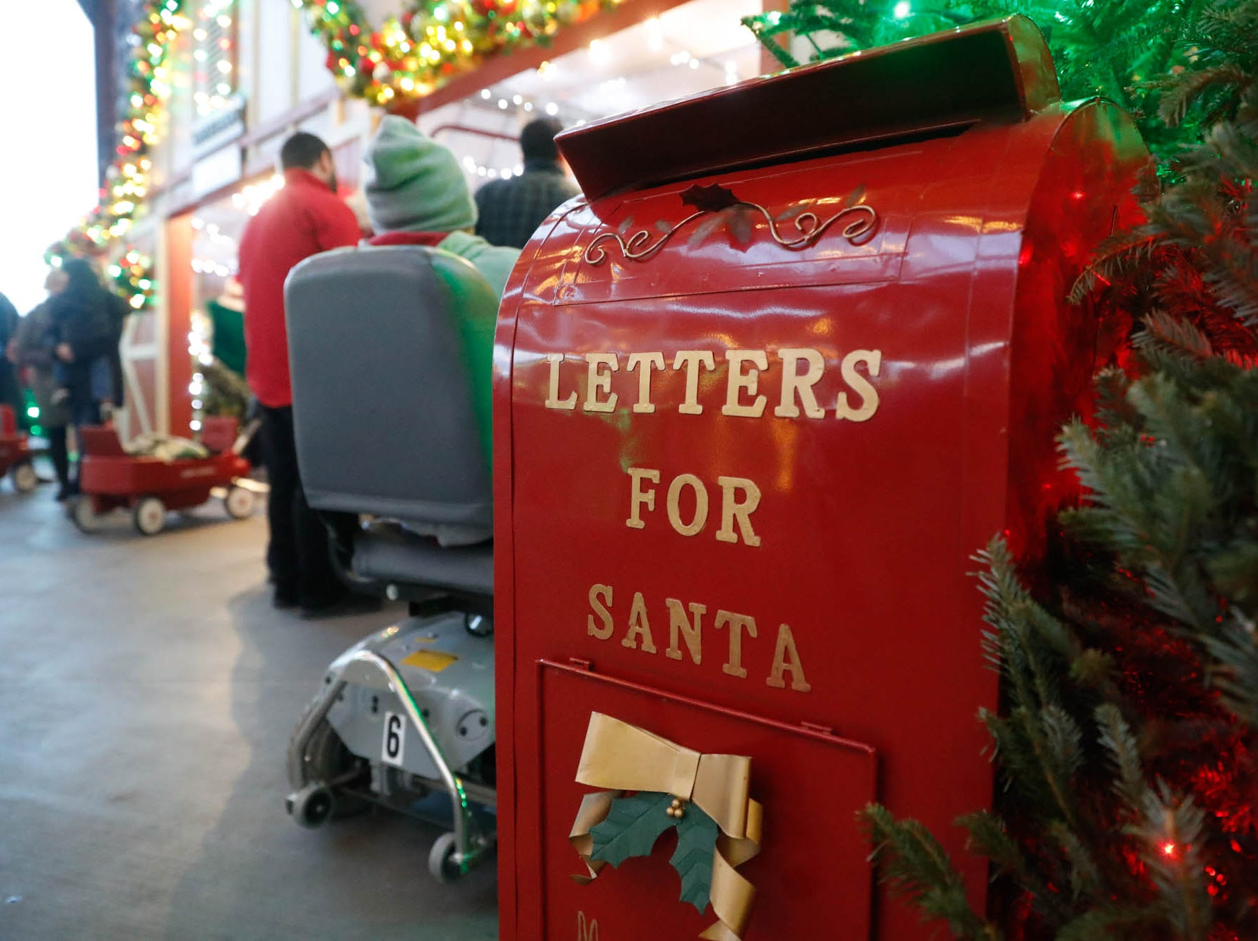 Guests can leave letters to Santa during Christmas at the Indianapolis Zoo on Wednesday, Dec. 19, 2018.