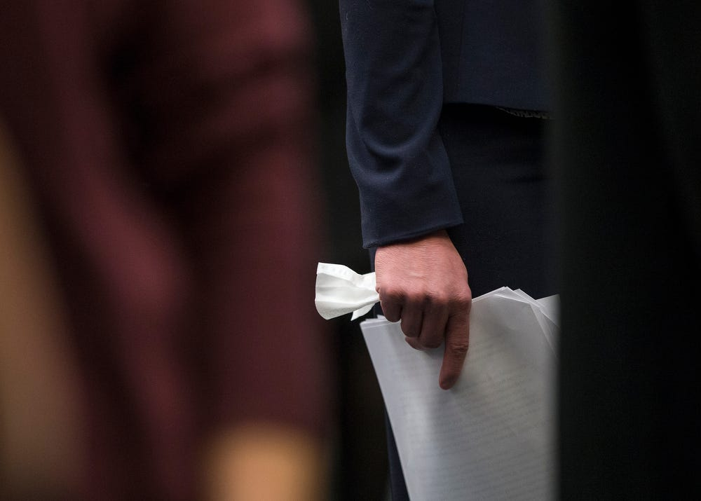 Rachael Denhollander holds her speech and a tissue after delivering her impact statement in front of former USA Gymnastics doctor Larry Nassar inside Ingham County Circuit Court in Lansing, Mich., Wednesday, Jan. 24, 2018.