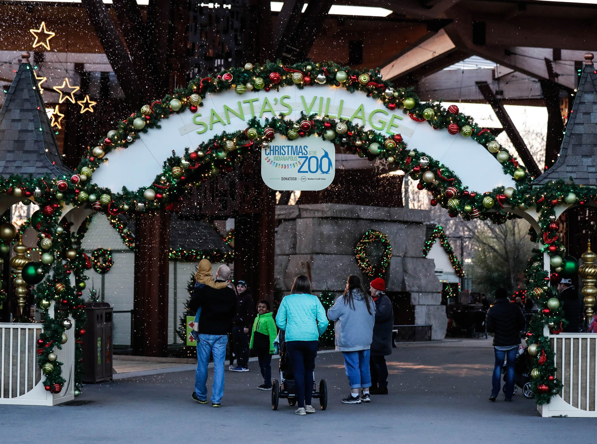 Guests enter Santa's Village during Christmas at the Indianapolis Zoo on Wednesday, Dec. 19, 2018.