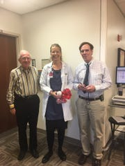 IU Health's Dr. Lawrence Einhorn (left) stands with Christina Tiller and Dr. Kenneth Kesler (right). Gudbjorn Johann says the three of them saved his life.