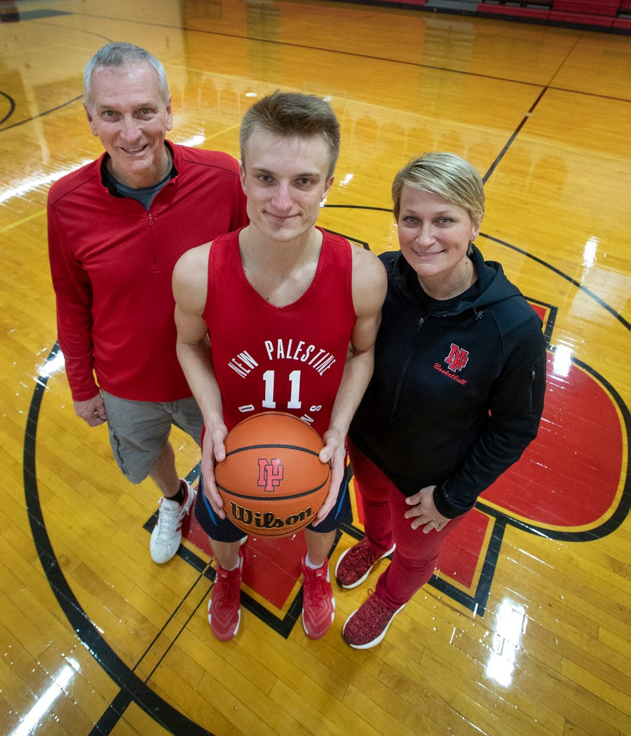 New Palestine basketball's Bruce Haynes, left, Maximus Gizzi and his mother Sarah Gizzi. Maximus is a standout junior point guard and his mother Sarah coaches New Pal's girls team. Sarah's father Bruce Haynes, a former New Pal boys coach, now helps Sarah with her team.