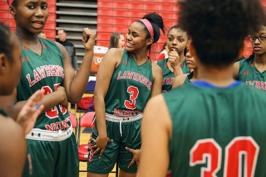 Lawrence North junior Trinity Brady (3), center, goofs around with teammates before a game at Center Grove High School, Greenwood, Ind., Friday, Jan. 26, 2018. A car accident in 2016 left Trinity with a traumatic brain injury, causing severe chronic head pain and mental setbacks like post-traumatic stress disorder and depression. In the past year, Trinity has finally found treatment to improve her chronic pain. While she is still working through some mental and physical setbacks, she is once again a leading scorer for Lawrence North.