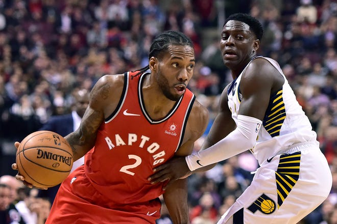 Toronto Raptors forward Kawhi Leonard (2) moves by Indiana Pacers guard Darren Collison (2) during the first half of an NBA basketball game, Wednesday, Dec. 19, 2018 in Toronto. (Frank Gunn/The Canadian Press via AP)