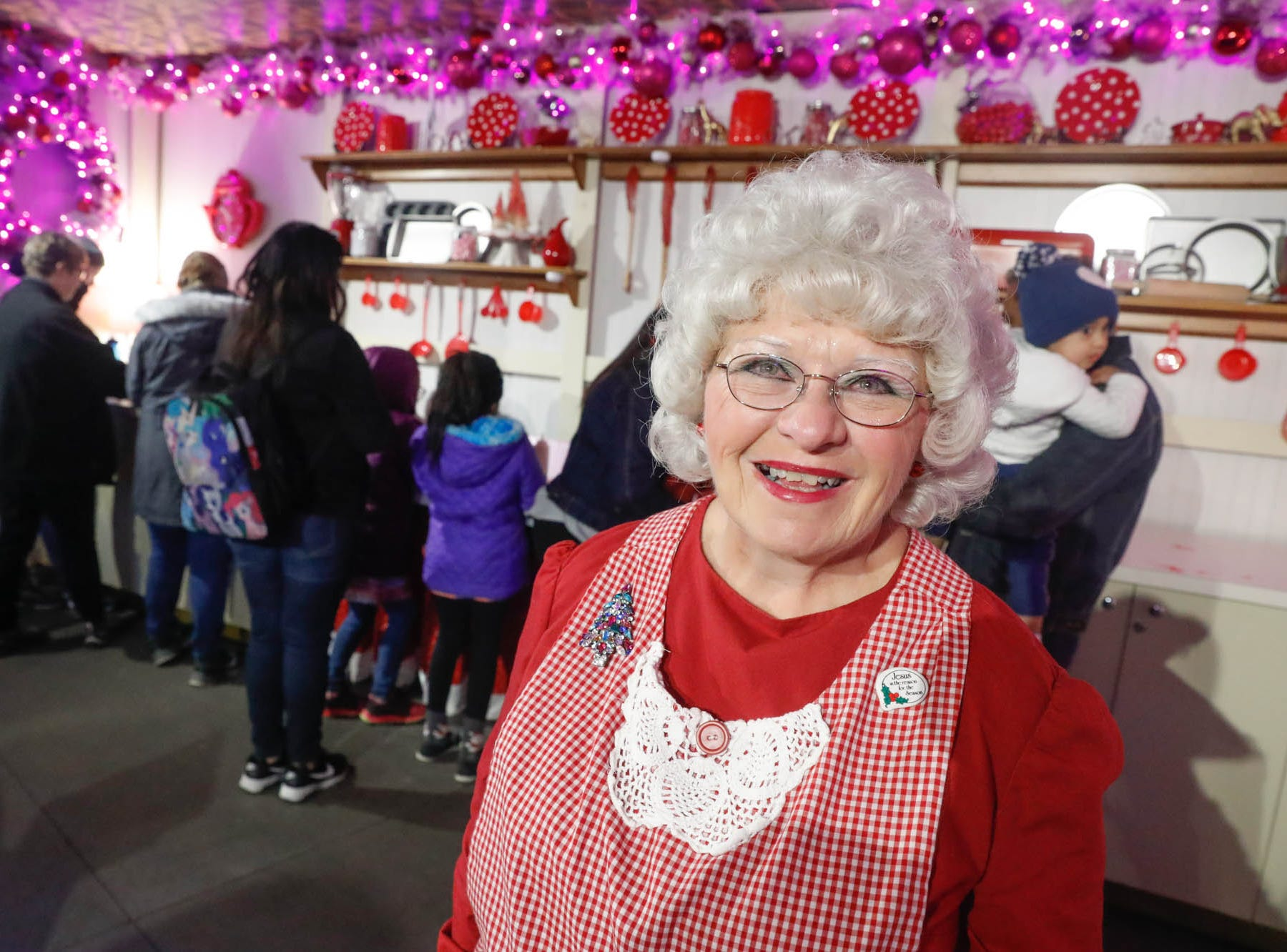 Mrs. Claws, also known at Cindy Heginbotham, greets guests who wish to decorate sweet treats during Christmas at the Indianapolis Zoo on Wednesday, Dec. 19, 2018.