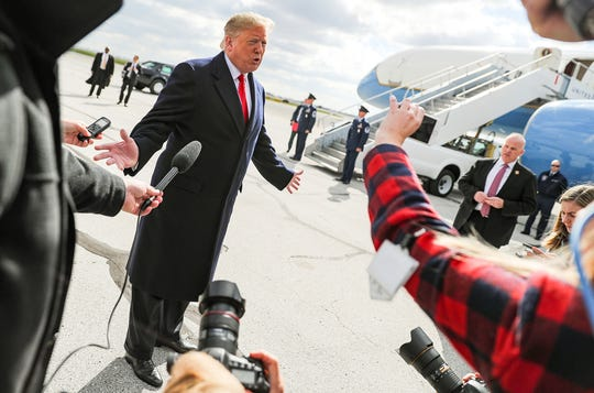 United States President Donald Trump briefly spoke to media after he exited Air Force One at Indianapolis International Airport, where he arrived to speak at the annual Future Farmers of America Convention and Expo at Banker's Life Fieldhouse, Saturday, Oct. 27, 2018. Trump said he planned to make a statement about the fatal shooting at a synagogue in Pittsburgh in his FFA speech.