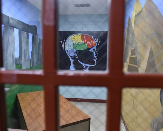 A patient evaluation room in the vacant Walnut Grove Correctional Facility is decorated with murals created by former inmates. Thursday, Dec. 20, 2018