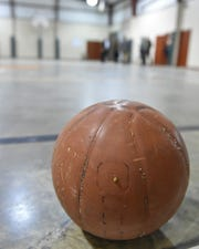 A basketball covered in bugs and dust sits on the floor of the indoor basketball court at the currently closed Walnut Grove Correctional Facility. Thursday, Dec. 20, 2018