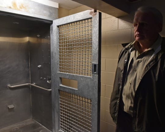Leake County Sheriff Greg Waggoner  stands outside a shower designated for maximum security inmates in the currently closed Walnut Grove Correctional Facility. Thursday, Dec. 20, 2018