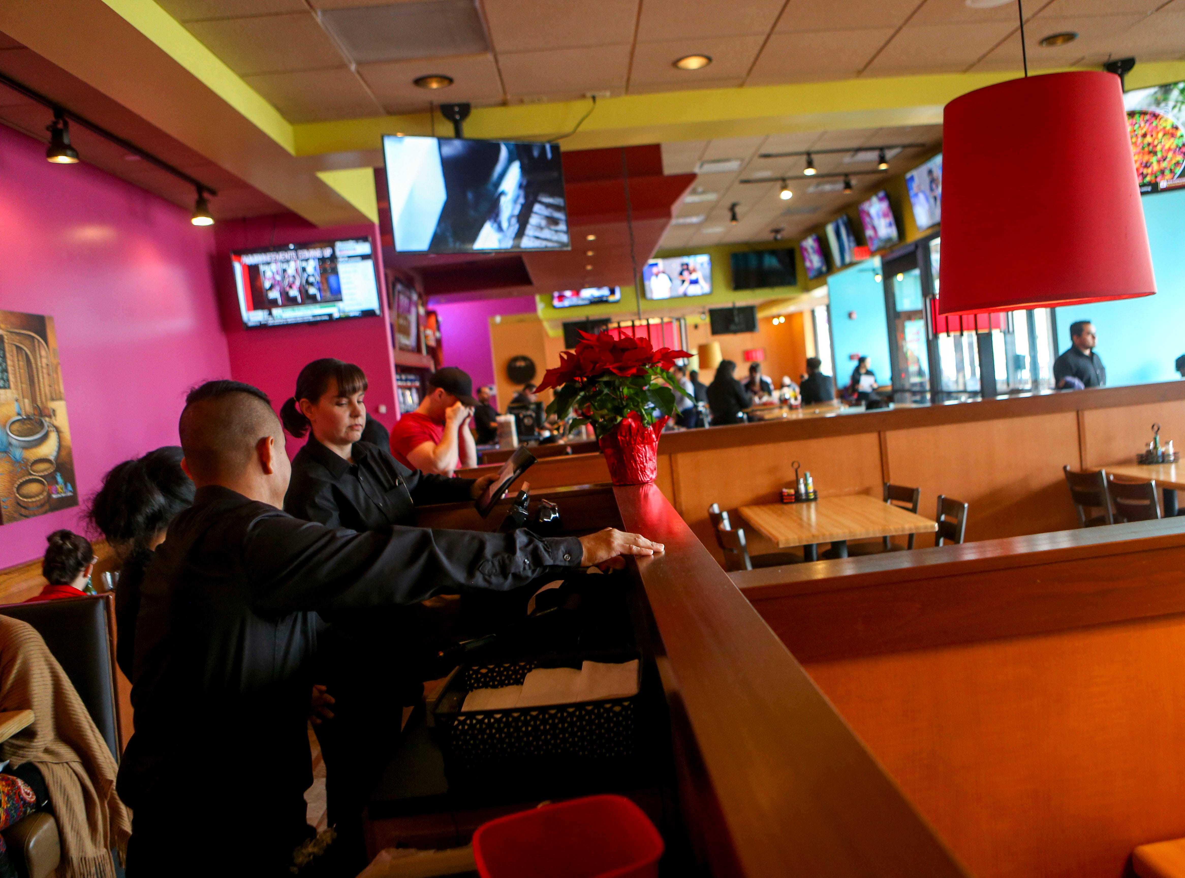 Wait staff look through options on the restaurants computers during the opening day at Te'Kila Mexican Bar & Grill in Jackson, Tenn., on Wednesday, Dec. 19, 2018.