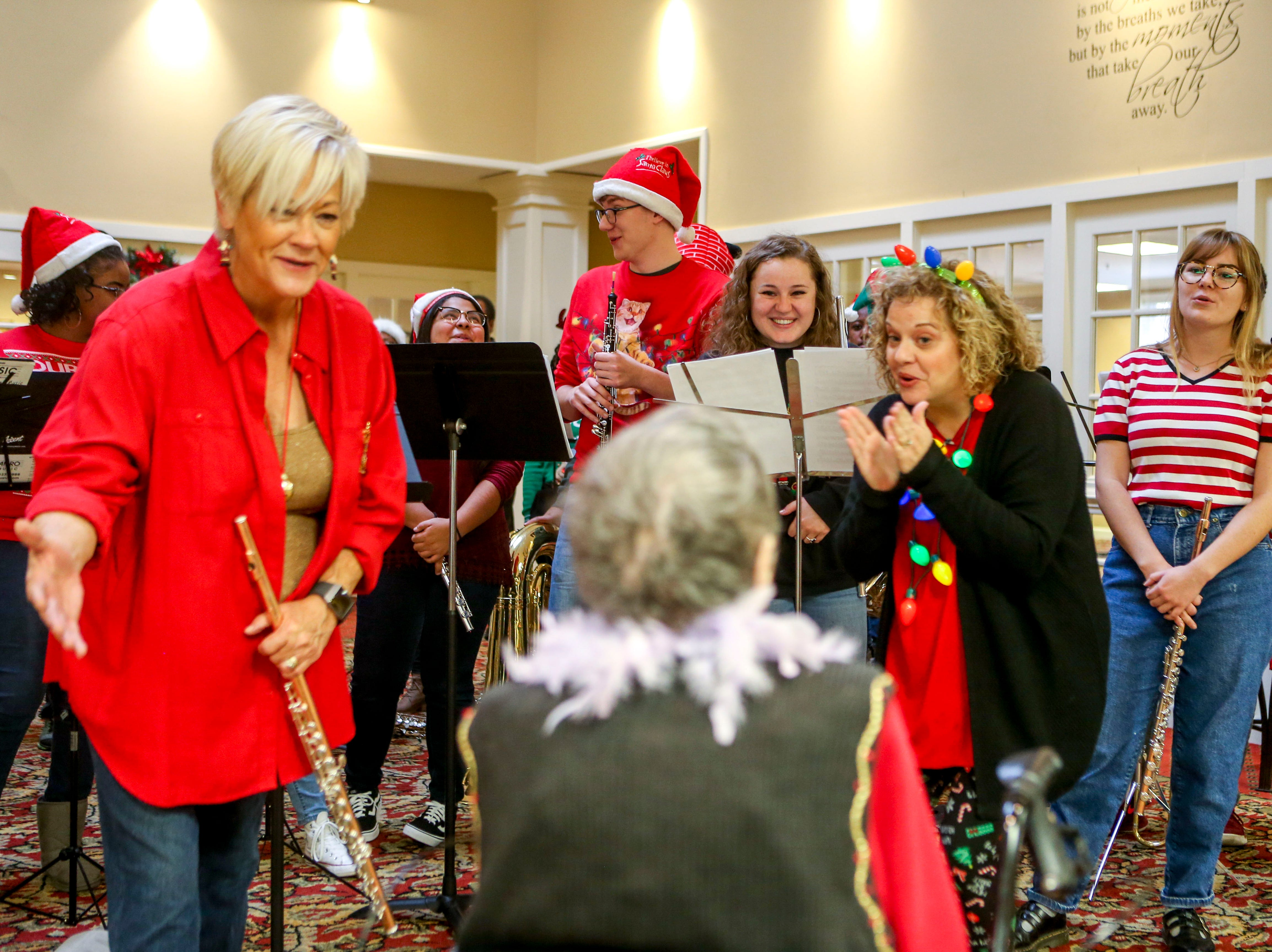 The Madison Academic High School band and choir sing happy birthday to Ida Feldman, who celebrated her 100th birthday the same day the students visited to sing Christmas carols to residents at Regency Retirement Home in Jackson, Tenn., on Thursday, Dec. 20, 2018.